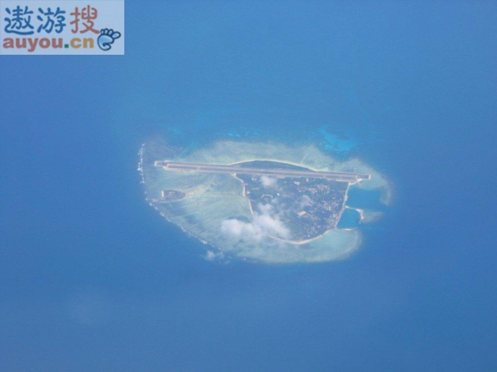 永兴岛全景鸟瞰永兴岛是一座由白色珊瑚贝壳沙堆积在礁平台上而
